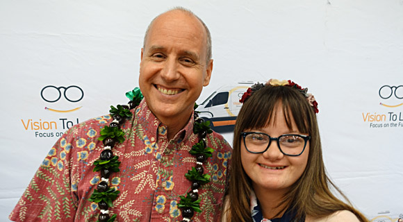 Pictured here with a Kahuku student, Harold K.L. Castle Foundation President and CEO Terrence R. George said, 'Vision is where success in life starts.'  Kahuku Hawaii, December 11, 2018.