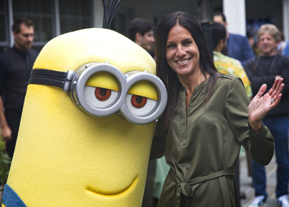 "One of Illumination's ""Minions"" poses with a Spring Spectacle guest"