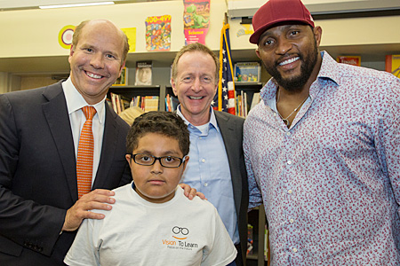 Congressman Delaney, Austin Beutner and Ray Lewis with Batimore Students receiving new glasses