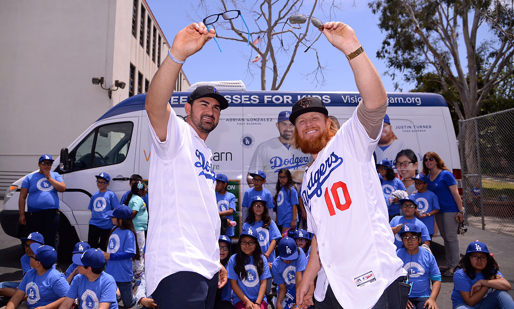 Justin Turner and Adrian Gonzalez help Vision To Learn pass out free eyeglasses to children