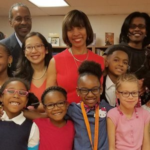 Baltimore Mayor Catherine Pugh with students after receiving their new glasses