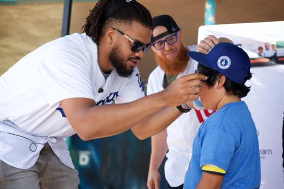 Los Angeles Dodgers Kenley Jansen and Justin Turner putting new glasses on a student, May 25, 2018