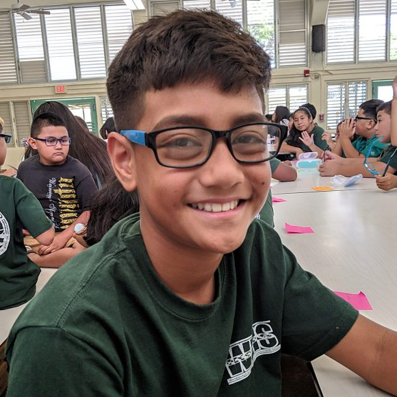 Student at WEIS shows off new glasses
