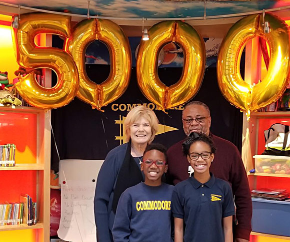 Ann Hollister and Wade Brown celebrate the 5,000th child to receive glasses from Vision To Learn, at Commodore John Rodgers Elementary/Middle School, December 10, 2018.