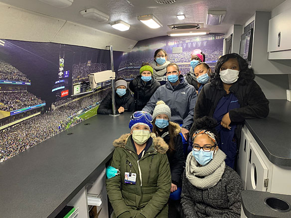 Health Care Workers take a break in Eagles Mobile Clinic