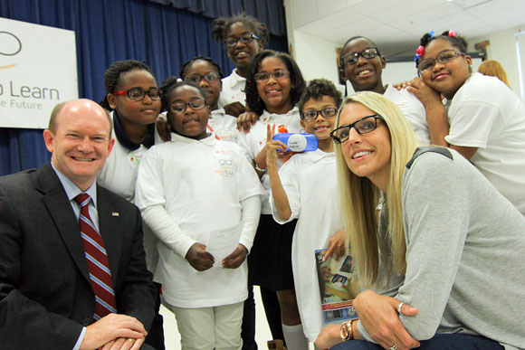 Senator Chris Coons and WBNA player Elena Delle Donne, a Delaware native, with children at the Vision To Learn Delaware kickoff event at Shortlidge Academy, October 2014.