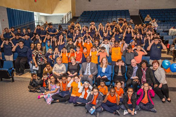Frank R. Conwell Middle School and Primary School students show off their new glasses!