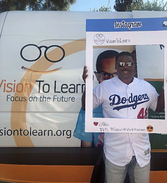 Dennis Powell helping Vision To Learn