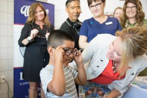 Des Moines Students receiving their glasses