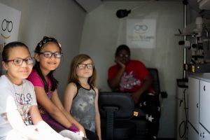Des Moines Students receiving their new glasses.