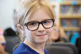 Des Moines student with new glasses