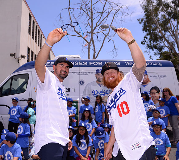 Adrián Gonzalez and Justin Turner help distribute glasses to kids at Betty Plasencia Elementary School in Los Angeles.