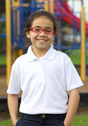 Girl on playground with new eyeglasses