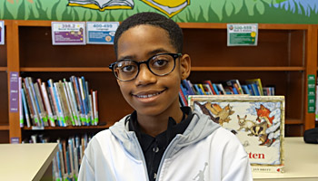Grand Rapids student shows off new glasses