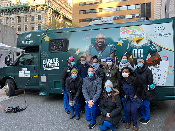 Health Care Workers in front of Eagles Mobile Clinic