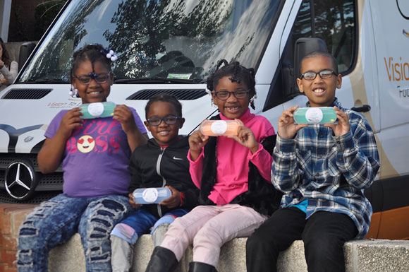 Elizabeth D. Redd Elementary School students with their new glasses in Richmond VA, October 2017.