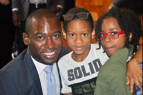 Mayor Levar Stoney with two kids who received glasses at Elizabeth D. Redd Elementary School in Richmond, October 2017.