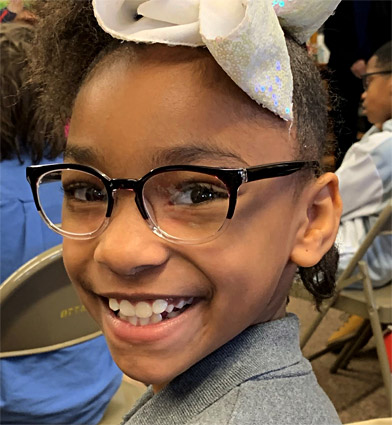 Student at Aberdeen School in Michigan shows off her new glasses