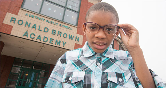 A Michigan student tries on a new pair of glasses.