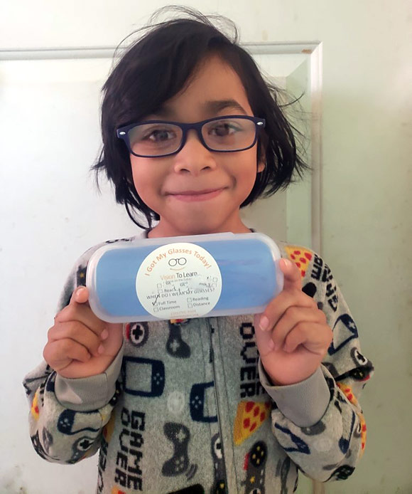 A student shows off their new glasses from home. During the pandemic, Vision To Learn delivered glasses to kids at their houses to help them with their virtual learning.