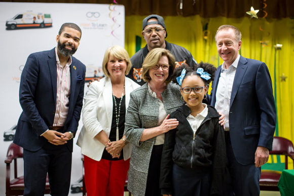 An Oak Forest Elementary student with her new glasses, with Jackson Mayor Chokwe Lumumba, Mississippi First Lady Deborah Bryant, Master P, Vision To Learn Mississippi Director Gayle Wicker, and Austin Beutner, April 26, 2018
