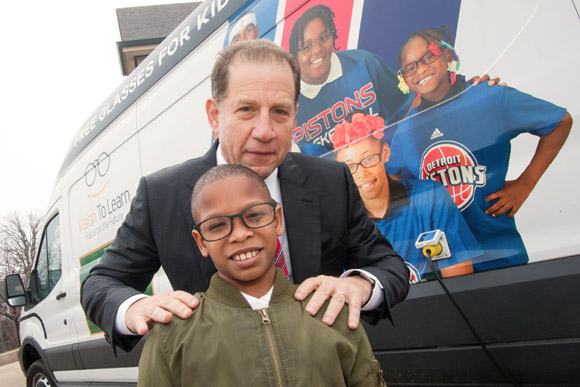 Arn Tellem is on hand to give kids glasses at Ronald Brown Academy in Detroit, February 2017.