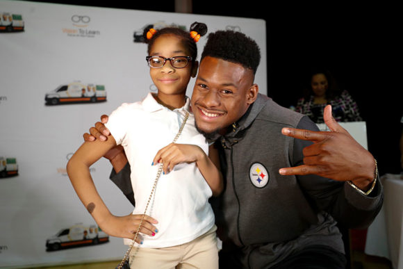 Pittsburgh Steeler JuJu Smith-Schuster helps Pittsburgh King student show off her new glasses, June 1, 2018