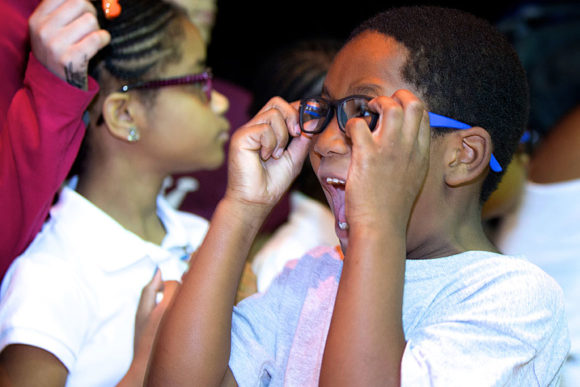 Boy show surprise at new glasses