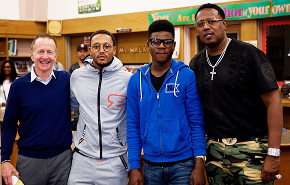 Austin Beutner, Romeo Miller, and Master P with a Crenshaw student.