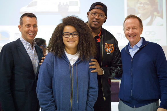David Plouffe, Master P, Austin Beutner with student from Ravenswood City School District showing off new glasses.