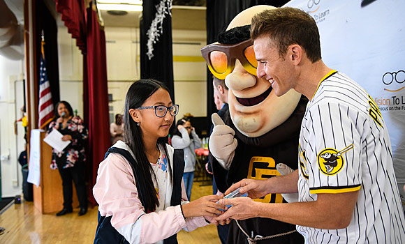 "Student receiving her new glasses from the Swingin' Friar and the ""Pad Squad, December 10, 2019."