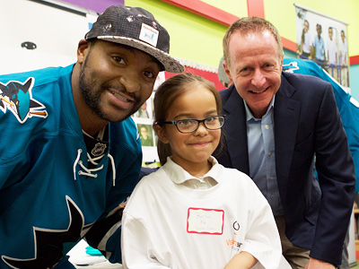 Sharks Forward Chris Tierney with a student at Selma Olinder Elementary