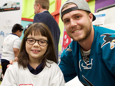 Sharks Right Wing Joel Ward, Austin Beutner, and a student modeling her new glasses
