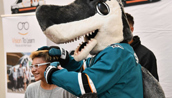 San Jose Sharks' mascot SJ Sharkie help Columbia Middle Schoolers try on their new glasses. Sunnyvale, CA, October 16, 2018.