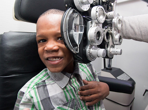 Student having eye exam