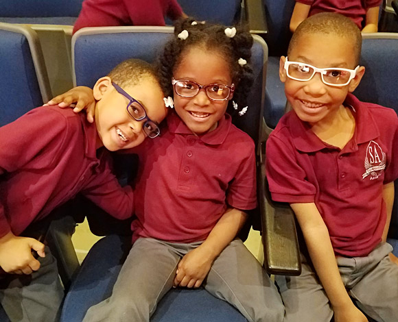 Smiles all around for these Speedway Academies students, who just received their new glasses!
