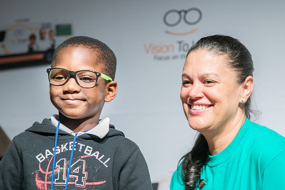 Superintendent of Atlanta Public Schools Meria Carstarphen with a student who just received glasses at Michael R. Hollis Innovation Academy in Atlanta, August 2017.