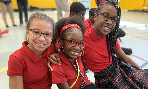 Three girls with new glasses in Philadelphia